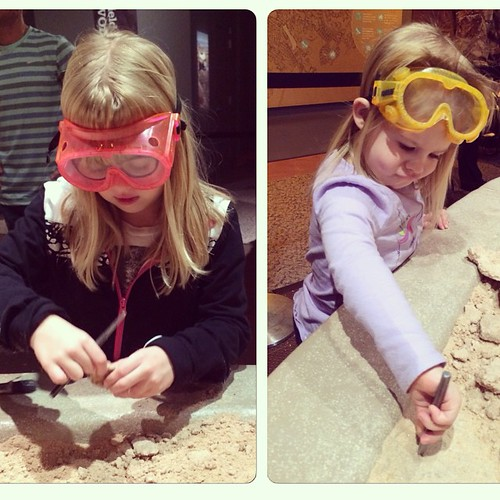 From this afternoon: serious excavation work happening at the science museum dino exhibit. Even though Lucy doesn't really understand the concept of goggles. #WLDinoNC