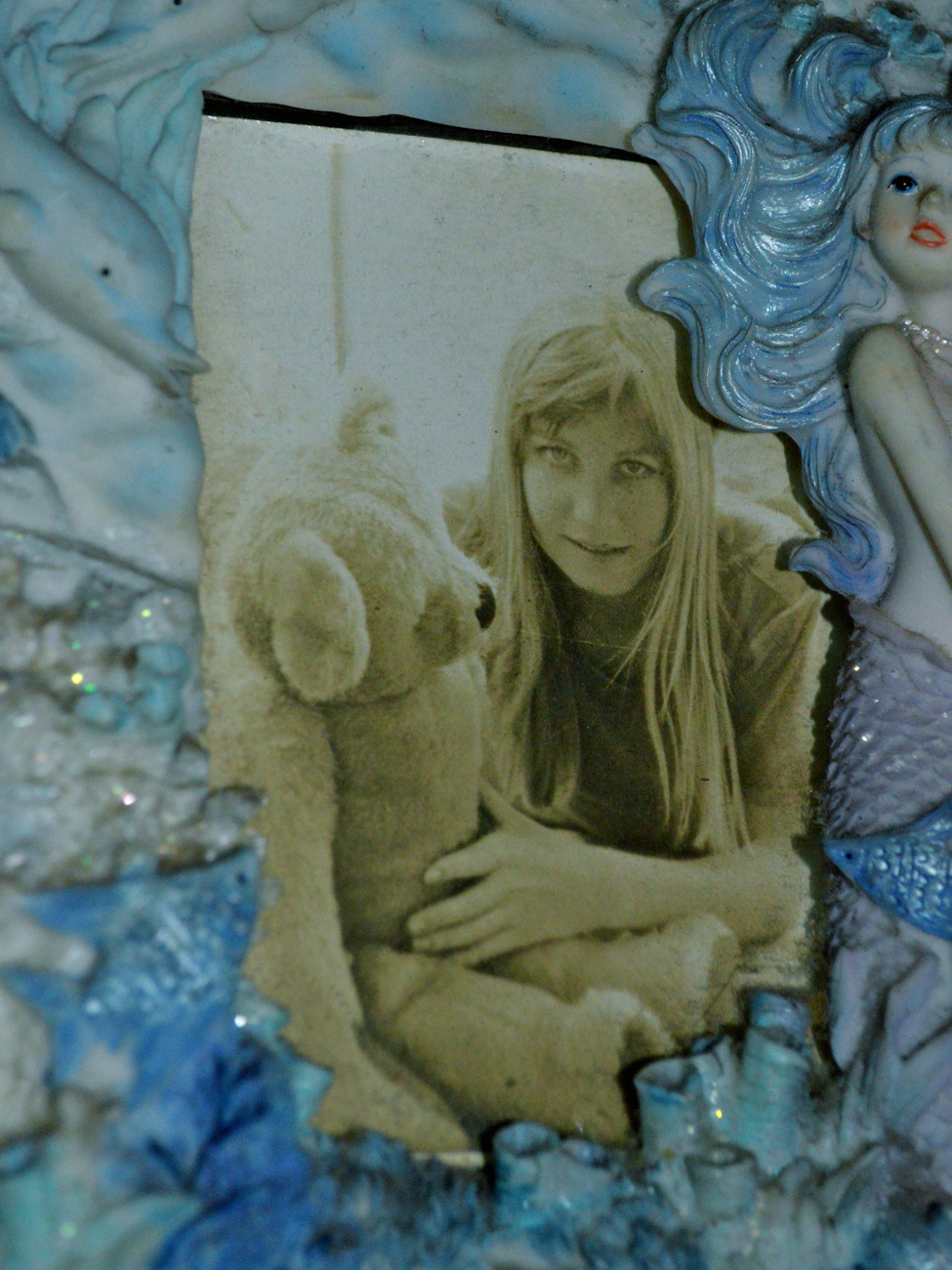 The mermaid, in her younger days,  with teddybear