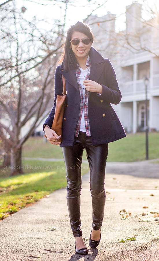 navy peacoat, plaid shirt, graphic tee, faux leather pants, cognac brown tote