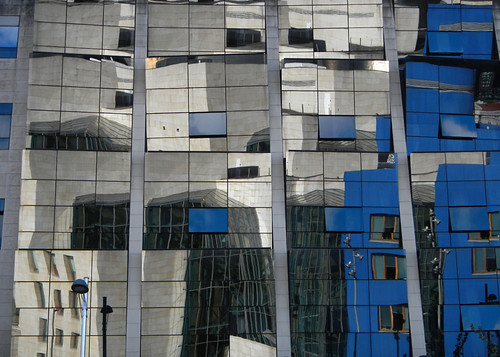 The Bilbao Guggenheim mirrored in the building opposite (Spain)