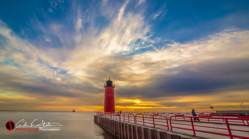 city blue orange sun lighthouse water wisconsin clouds sunrise canon landscape downtown waves cityscape place unitedstates horizon lakemichigan greatlakes milwaukee lakefront thirdward mke 3rdward milwaukeewi landscapephotography discoverwisconsin pierheadlighthouse travelwisconsin 5dmarkiii piermilwaukee wicounties