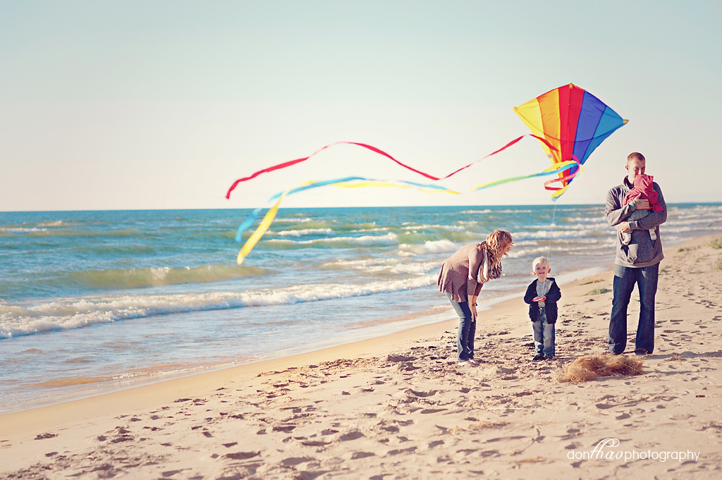 Family on beach with kite photography