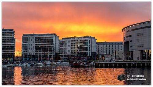 uk sunrise reflections belfast northernireland countyantrim belfastlough titanicquarter clarendondock