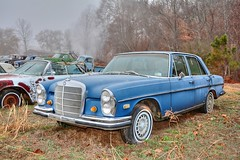 mercedes-benz w114(0.0), compact car(0.0), automobile(1.0), automotive exterior(1.0), vehicle(1.0), performance car(1.0), mercedes-benz w108(1.0), mercedes-benz(1.0), mercedes-benz w111(1.0), antique car(1.0), sedan(1.0), classic car(1.0), vintage car(1.0), land vehicle(1.0), luxury vehicle(1.0), convertible(1.0), motor vehicle(1.0),