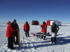 Drilling one of six shallow cores at the drill site for snow density measurements
