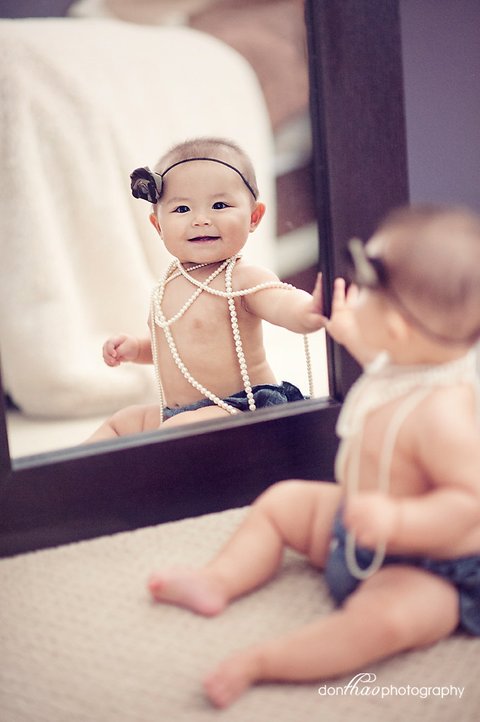 baby girl looking in mirror toddler photography in Hudsonville, Michigan