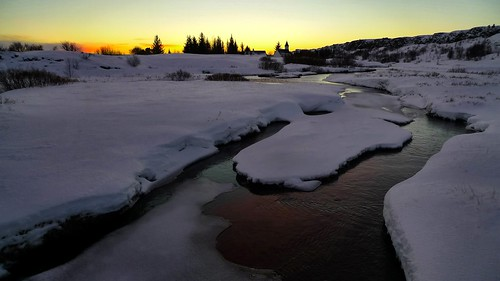 sunset snow river iceland thingvellir