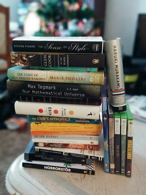 An example of the Lens Blur setting on my camera: a stack of books are in focus in the foreground, while the Christmas tree and living room in the background are blurry.