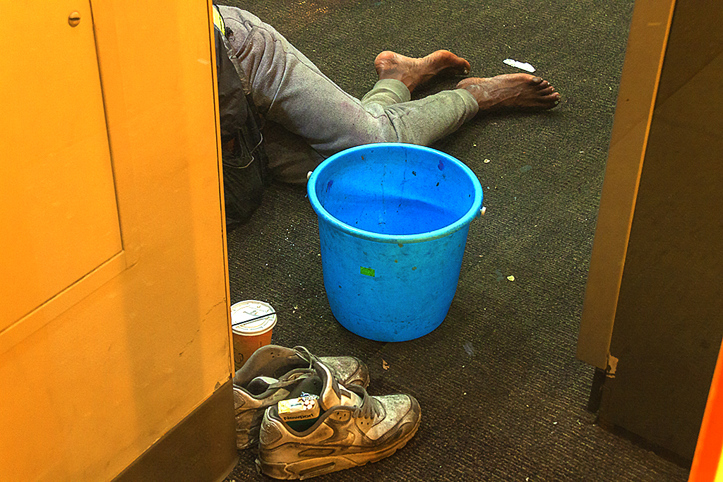 Homeless sleeping inside ATM vestibule--Center City
