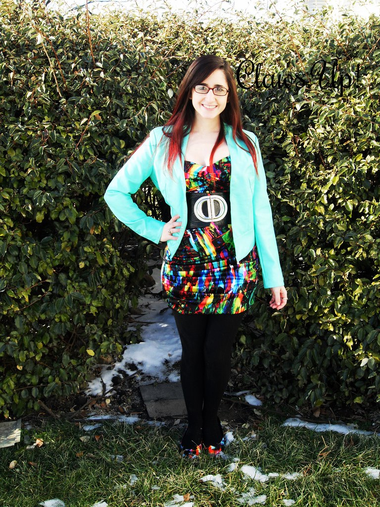 colorful dress, black belt, and mint jacket for a new years eve outfit
