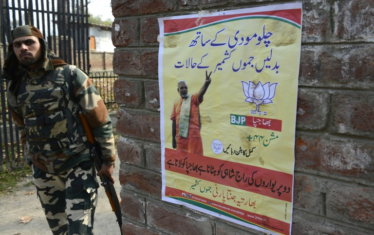 A BJP poster in Tral, Pulwama district, ahead of the 2014 Assembly election. Image credit: AFP