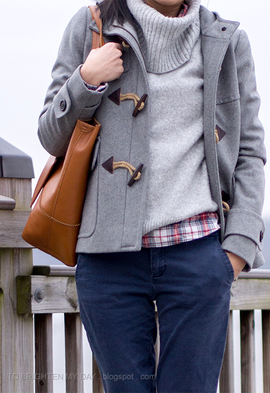 gray toggled coat, gray turtleneck sweater, plaid shirt, navy khakis, cognac brown tote