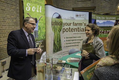 "David Lamm, NRCS National Soil Health  and Sustainability Team Leader, East National Technology Support Center, Greensboro, NC, explains soil health to Jill Luxenburg at USDA's NRCS, ""Behold Our Living Soil"" exhibit at NRCS celebration of the International Year of Soils at USDA in Washington, D.C. on Tuesday, Jan. 6, 2015. The event was to highlight the importance of healthy soils for food security, ecosystem functions and strong farms and ranches. USDA photo by Bob Nichols."