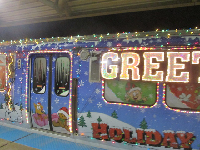 Outbound Holiday train stops at Oakton-Skokie station