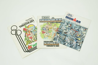 """Sun, 11/23/2014 - 15:01 - 6.Early Ironman race programs (Feb '81, Feb 82, and October '83 shown here) listed every race entrant and their occupation. The program covers were the same art as the race posters. At some point, a few of the top competitors began disguising their (lack of) occupation. Paul Huddle was listed as a """"Lambada instructor"""" and Tom Gallagher was noted as a """"Crossing Guard.""""  Race Director, Valerie Silk didn't think the joke was very funny and began labeling most of the top athletes' occupation as """"professional athlete"""" even though there was no prize money in the event. Dave Scott's occupation for years was listed as """"fitness consultant,"""" which nobody understood because there wasn't much to consult on and certainly Dave wasn't offering any secrets back then."""