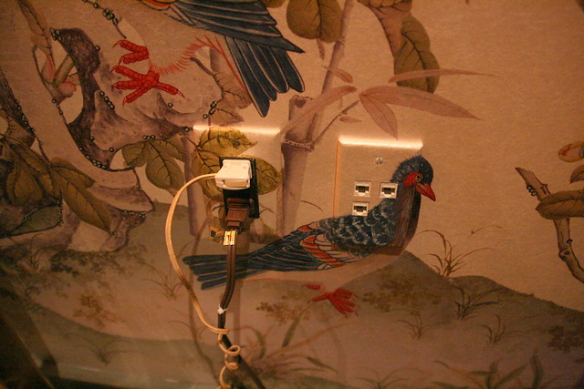 Attention to detail: they even painted the electrical socket plates to match the wallpaper