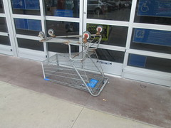 floor(0.0), outdoor structure(0.0), vehicle(0.0), handrail(0.0), mast(0.0), cart(0.0), iron(1.0), shopping cart(1.0),