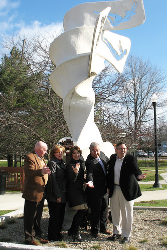 Rural Housing Service Administrator Tony Hernandez, Michigan State Director James Turner, and Plainwell, Michigan community members at the new City Hall sculpture.