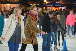 Picture Of Women Skating At Citi Pond Ice Skating At Bryant Park In New York City. Citi Pond Ice Skating Started October 21, 2014 And Ends Sunday March 1, 2015. Photo Taken Thursday December 4, 2014