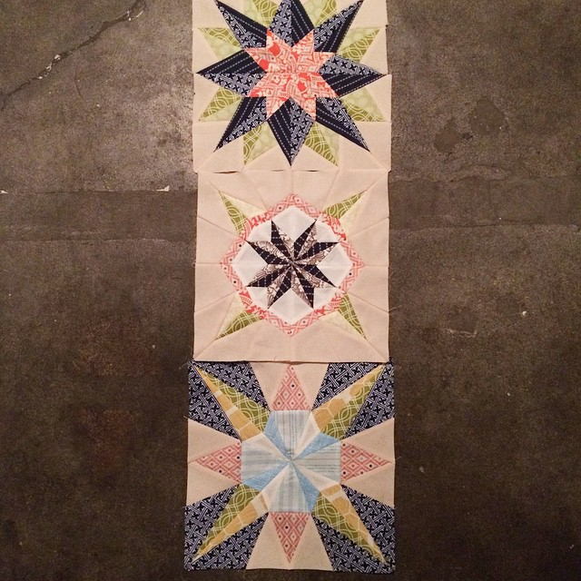3 pretty blocks but I'm not sure they are pretty together as a table runner. Should have left the navy out of the corners on the bottom one. Looks like a 4th block will need to be made... Sigh. #Christmassewcial #luckystarsbom