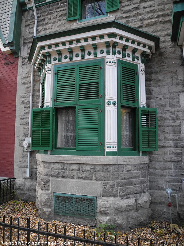 Beautiful ornate window and window shutters