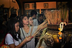 Burning Joss sticks in the hope of bringing wealth and health