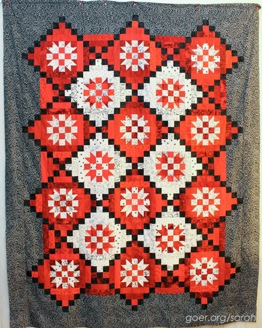 completed red, black and white mystery quilt top