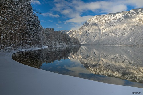 travel trees winter shadow sky mountain lake snow alps reflection heritage tourism nature water ecology sport clouds forest landscape mirror julian europe view walk scenic tranquility landmark location slovenia recreation relaxation hdr bohinj preservation centraleurope gorenjska triglavnationalpark