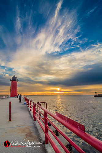 city blue orange sun lighthouse water wisconsin clouds composition sunrise canon landscape downtown waves cityscape place unitedstates lakemichigan greatlakes milwaukee hdr lakefront thirdward mke 3rdward milwaukeewi landscapephotography pierheadlighthouse 5dmarkiii piermilwaukee