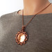 Copper Sunburst Pendant On by Ruth Jensen