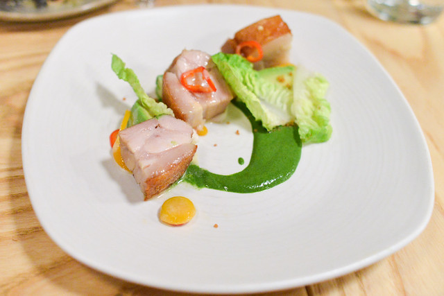 WARM PORK BELLY & AVOCADO SALAD Thai Basil Cilantro Puree, Pickled Chilies, Charred Scallion Vinaigrette