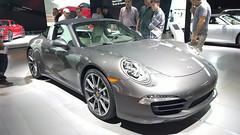 porsche boxster(0.0), automobile(1.0), automotive exterior(1.0), wheel(1.0), vehicle(1.0), performance car(1.0), automotive design(1.0), porsche 911(1.0), porsche(1.0), auto show(1.0), land vehicle(1.0), luxury vehicle(1.0), coupã©(1.0), convertible(1.0), supercar(1.0), sports car(1.0),