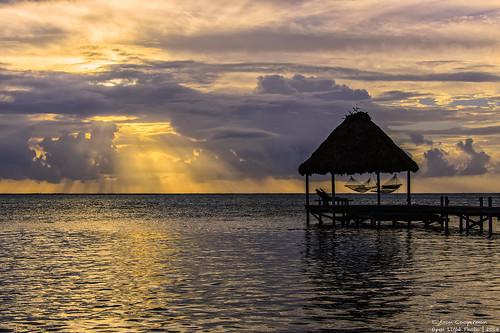 morning seascape latinamerica water clouds sunrise landscape pier dock nikon belize earlymorning ambergriscaye sanpedro centralamerica lightrays d800 caribbeansea nikond800 cloudsstormssunsetssunrises aroncooperman openlightphoto december2014