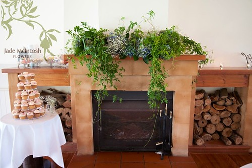 Fireplace wedding flowers.