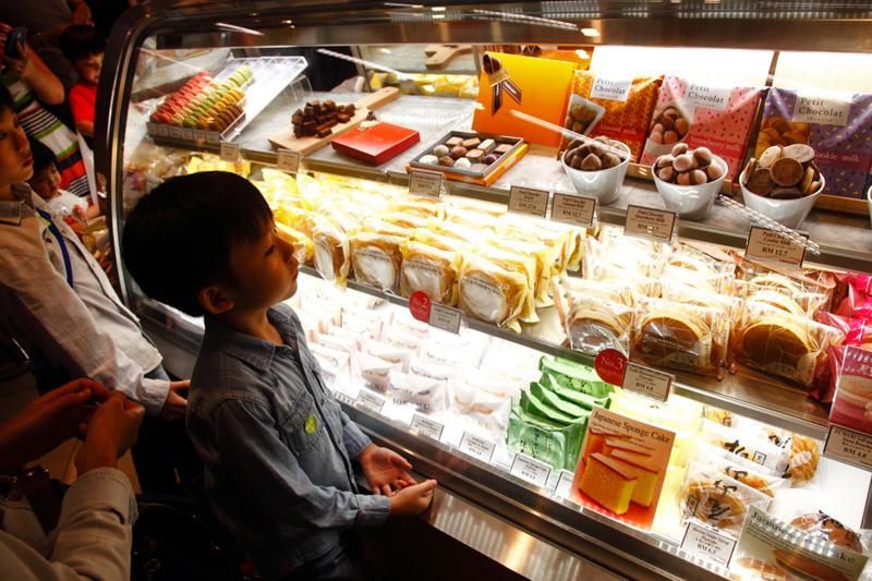 Kid Looking at Cake Display