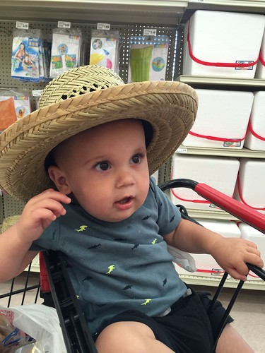 Theda puts a straw hat on Sawyer and he actually looks pretty good