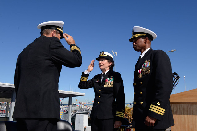 CORONADO, Calif. - Cmdr. Julie A. Grunwell reports to Commander, Naval Beach Group One, Capt. Kevin P. Flanagan that she has taken command of Assault Craft Unit One (ACU 1) from Cmdr. Victor A. Lake (right) during a change of command ceremony.