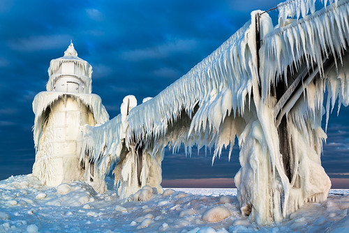travel winter light sea sky lighthouse white lake snow cold building ice nature water weather clouds sunrise outdoors pier frozen midwest unitedstates michigan scenic stjoseph landmark structure lakemichigan greatlakes beacon saintjoseph hoth echobase johncrouch stjosephlighthouse johncrouchphotography extremeice