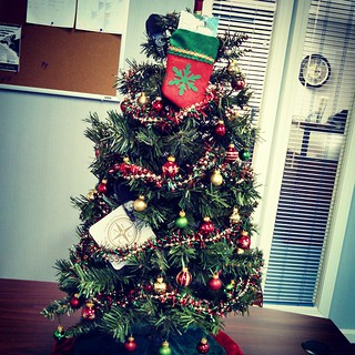 What I did at work today... Local businesses donate table top trees for a raffle which benefits Toys For Tots.   #ilovemyjob #toysfortots #christmas #tree