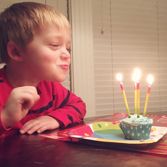 Blowing out four candles like a boss! A great way to end the big 4th birthday! #birthday #tate #candles #love #four