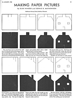 Cutting a construction paper house