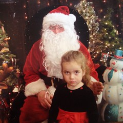 Someone was very #brave and sat with #Santa.