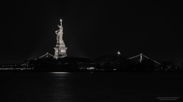 Statue of Liberty against the Verrazano-Narrows Bridge