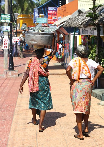 Fishmongers carrying fish in India