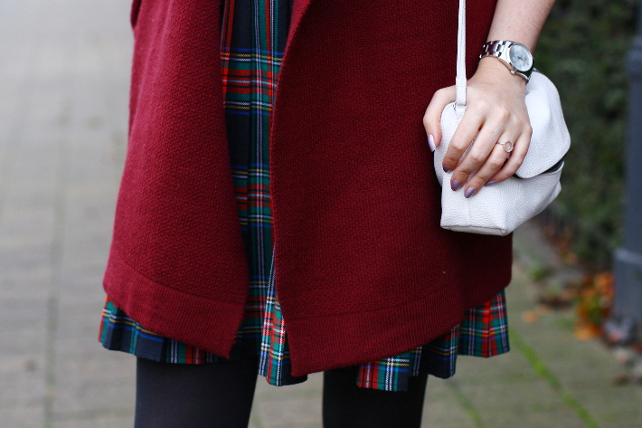 plaid skirt, burgundy cardigan, white cross body bag