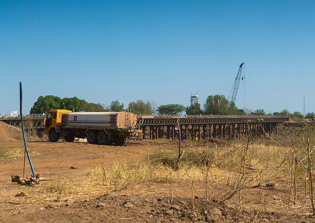 Metal bridge being built by chinese workers above omo river, Omo valley, Kangate, Ethiopia