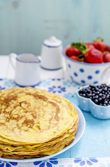 beautiful and thin pancakes lie with strawberry on…