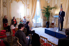 U.S. Ambassador to France Jane Hartley, far left, watches as U.S. Secretary of State John Kerry addresses a news conference at the U.S. Ambassador's Residence in Paris, France, on November 20, 2014, before traveling to Vienna, Austria, to join negotiations with Iranian officials about the future of their nuclear program. [State Department photo/ Public Domain]