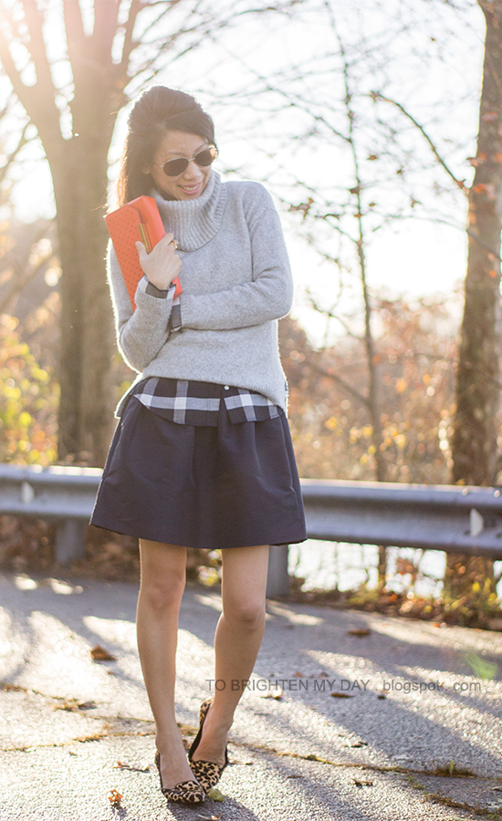 gray cowlneck sweater, navy plaid shirt, navy full skirt, orange clutch, leopard flats