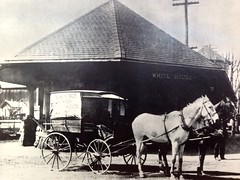 coachman(0.0), amish(1.0), vehicle(1.0), history(1.0), horse and buggy(1.0), land vehicle(1.0), carriage(1.0), cart(1.0),